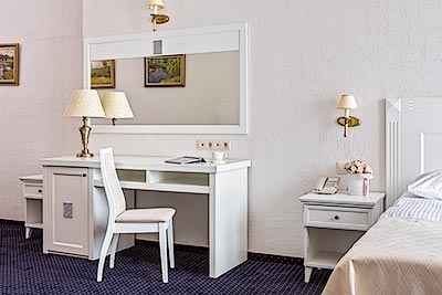 Business-class hotel room with furniture of the Art-Niko factory, made in classic style in white colors
